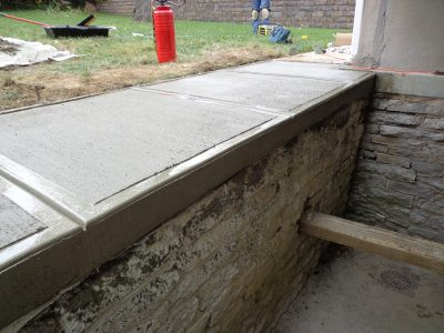 basement step retaining wall repair door replacement concrete floor