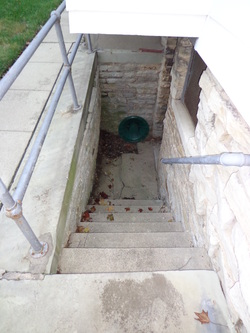 Hughes Construction Company Was Hired By The Homeowner To Fix The Bulge In  A Retaining Wall That Is Next To The Exterior Basement Stairs.